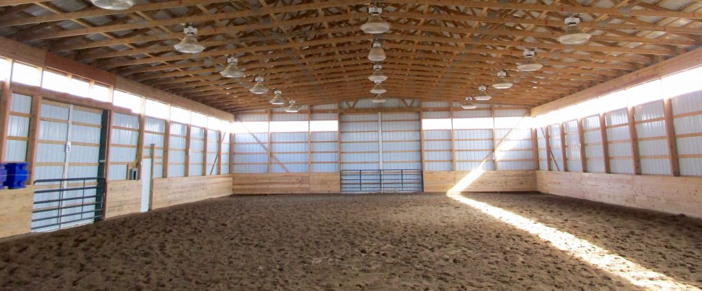 Ramiro & Kirstin – South Bend, IN 60 x 104 x 16 Horse Riding Arena, and a 42 x 24 addition with horse stalls. Tack room also was built. Green roof, trim, and wainscoting, with white sides